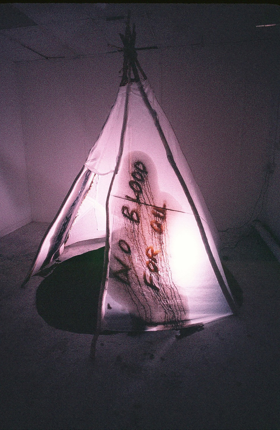 Red Breath ('no blood for oil' tipi graffiti) - live artwork by contemporary Plains Cree artist Jude Norris