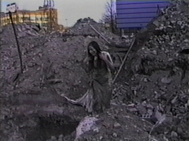 'toxic soil' live artwork for video (video still) - performance art by contemporary Plains Cree artist Jude Norris