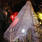 Tender Trading Tipi back and landscape - contemporary Native American performance art by Jude Norris